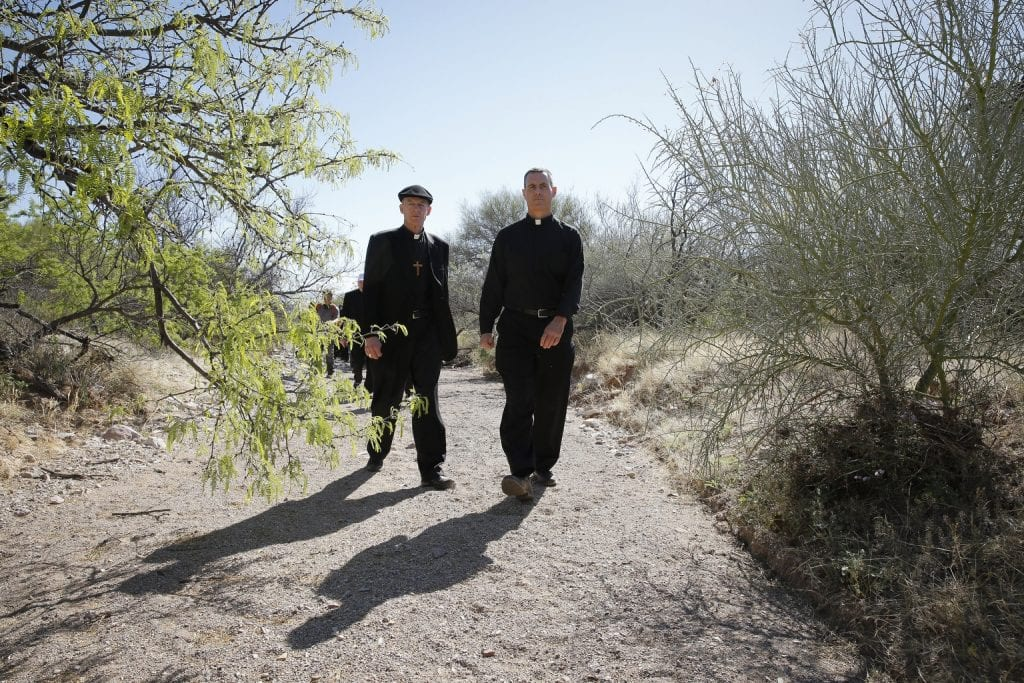 Bishop Wester pictured in 2014 photo with Jesuit Father Sean Carroll in Arizona desert