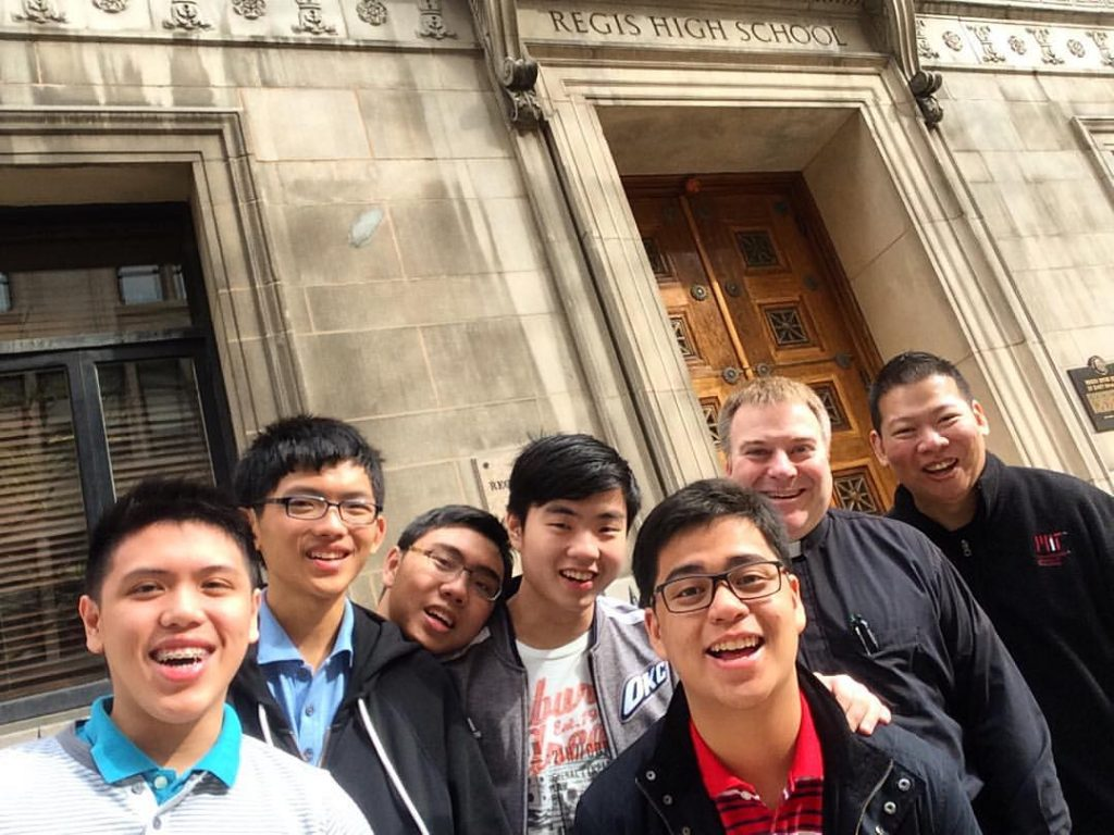 Father Gibbons (second from right) with a group of students at Regis High School in New York City.