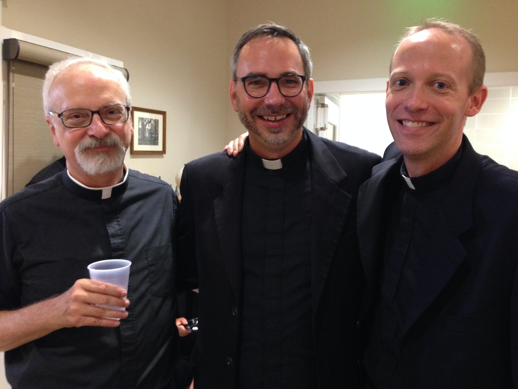 Father Thibodeaux flanked by fellow Jesuit Fathers Billy Huete (left) and Drew Kirschman (right).