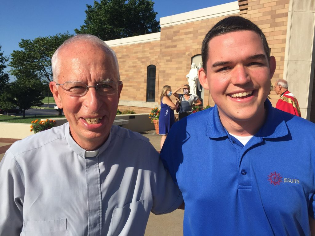 Crowe with deacon Lonnie Weishaar. It was Mr. and Mrs. Weishaar who first encouraged Crowe to look into the Jesuits.